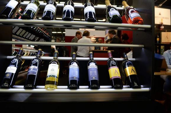 Source: Jean-Pierre Muller—AFP/Getty Images Bottles are pictured at a stand of the Vinexpo wine fest in Bordeaux, on June 15, 2015.