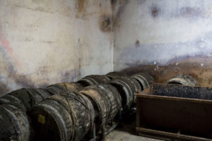 The wine is stored in ancient casks or by the case. Photographer: Lauren Fleishman/Bloomberg Markets